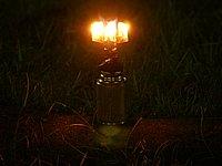 点灯した状態のG-メタルランプ。反射率の高いリフレクターによって、照射方向では3灯に近い明るさを実現。